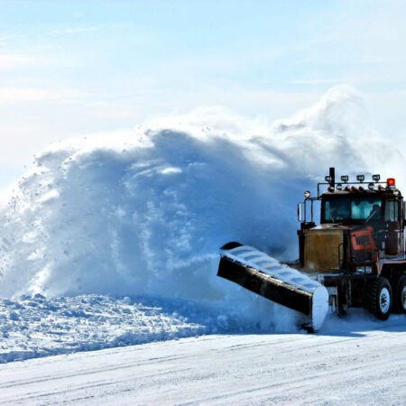 Snow Plow Throwing Snow
